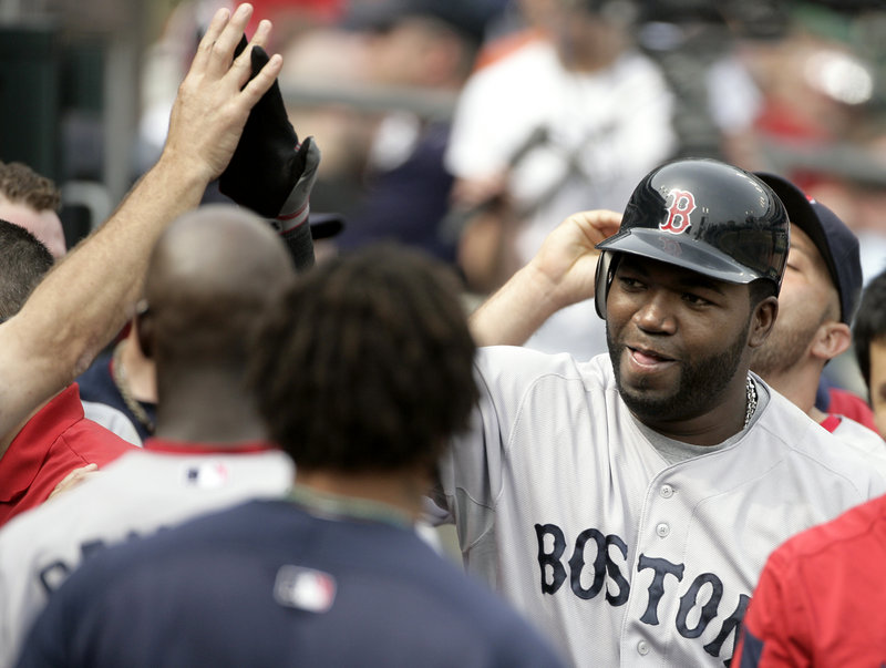 David Ortiz is congratulated by teammates after hitting a pinch-hit home run in the top of the ninth inning Sunday to help the Red Sox take a 4-3 win in the first game.