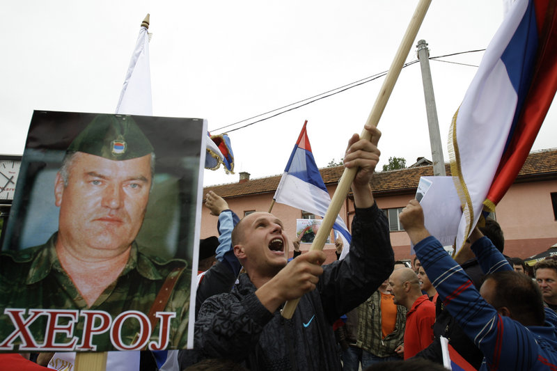 Demonstrators wave Serbian flags and hold photos of former Gen. Ratko Mladic in Kalinovik, Bosnia, hometown of the Bosnian Serb wartime military leader, on Sunday.
