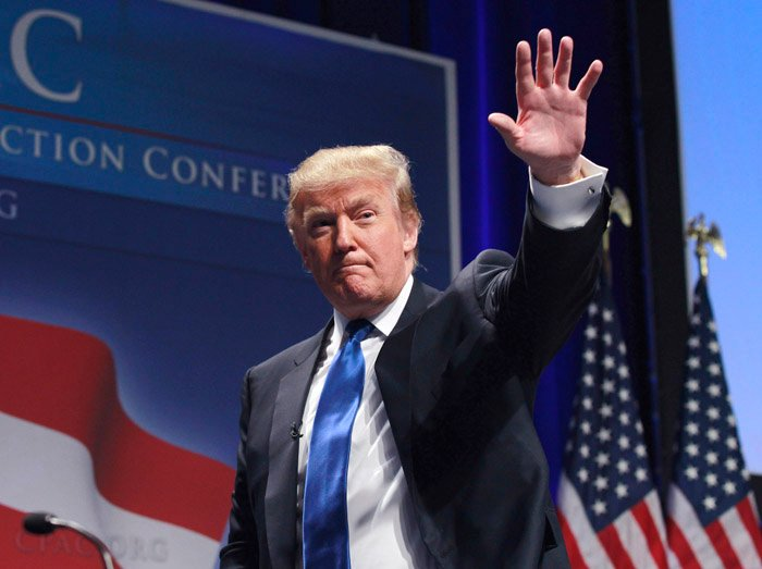 Donald Trump waves after addressing the Conservative Political Action Conference in Washington on Feb, 10, 2011.