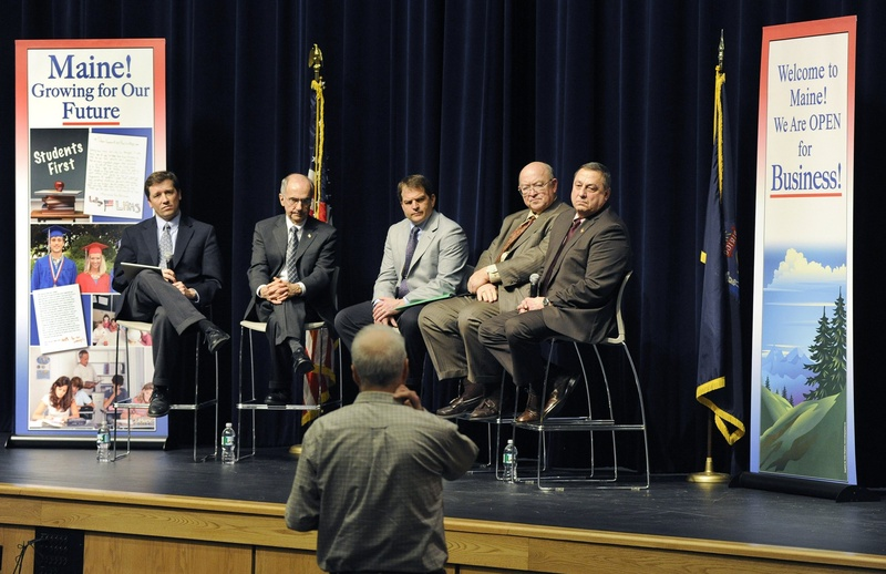 """Maine Gov. Paul LePage, right, and four commissioners, left to right, Steve Bowen, Darryl Brown, David Bernhardt and Phil Congdon, listen to a question during a """"Capitol For A Day"""" meeting in Westbrook in February. Listening also was the key for legislators who came up with regulatory reform that won broad approval."""