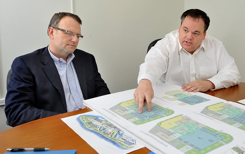 "Bill Ryan Jr., left, and Jon Jennings, discuss plans to develop Thompson's Point into an arena/convention center complex they call ""The Forefront at Thompson's Point"" during a meeting in April. City councilors approved a tax break for the project Monday night."