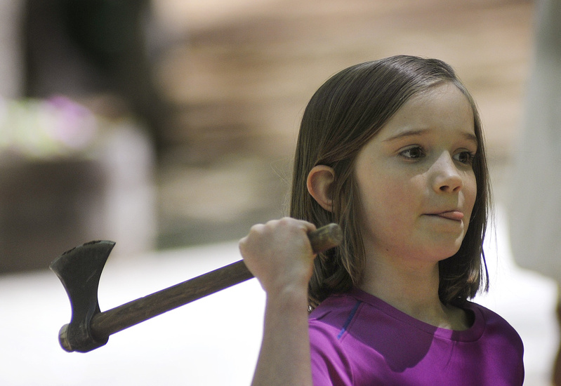 Alex Bunker, 8, of Brunswick concentrates as she tries her hand at throwing a tomahawk.