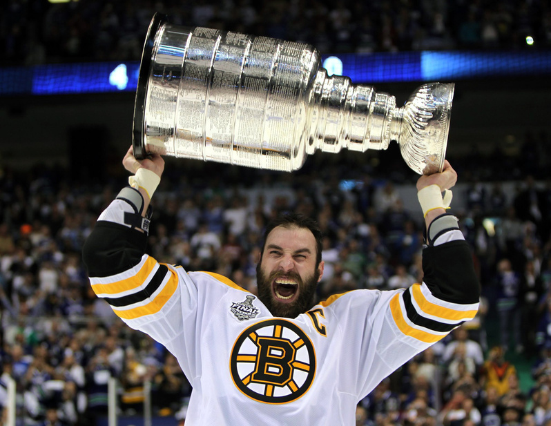 Bruins captain Zdeno Chara hoists the Stanley Cup after Boston beat the Vancouver Canucks on their home ice last week for the NHL title. Would it be fun for 6-foot-9 Chara to team up with 5-foot-4 Charo for a tour?