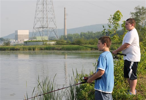 In this May 29, 2010 file photo, Shawn Cole, 12, of Hinsdale, N.H., left, and Peter Rosploch, 11, of Winchester, N.H. fish in the Connecticut River across from the Vermont Yankee nuclear power plant. In 2010, the Vermont Senate was so troubled by tritium leaks as high as 2.5 million picocuries per liter at the Vermont Yankee reactor in southern Vermont (125 times the EPA drinking-water standard) that it voted to block relicensing _ a power that the Legislature holds in that state. But in March 2011, the NRC granted the plant a 20-year license extension, despite the state opposition. Afterwards, operator Entergy sued Vermont in federal court, challenging its authority to force the plant to close. (AP Photo/Jason R. Henske)