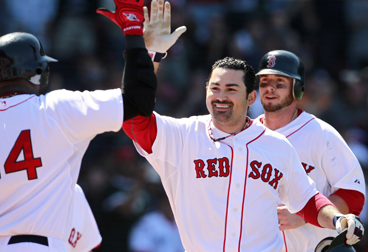 Boston Red Sox's Adrian Gonzalez, center, celebrates his two-run home run that drove in Jarrod Saltalamacchia, right, in Sunday's game against the Athletics.