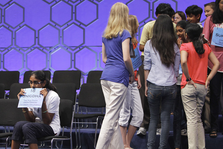 Snigdha Nandipati, 13, from San Diego, Calif., left, continues to concentrate as other spellers chat during a break in competition during the semifinals of the National Spelling Bee today.