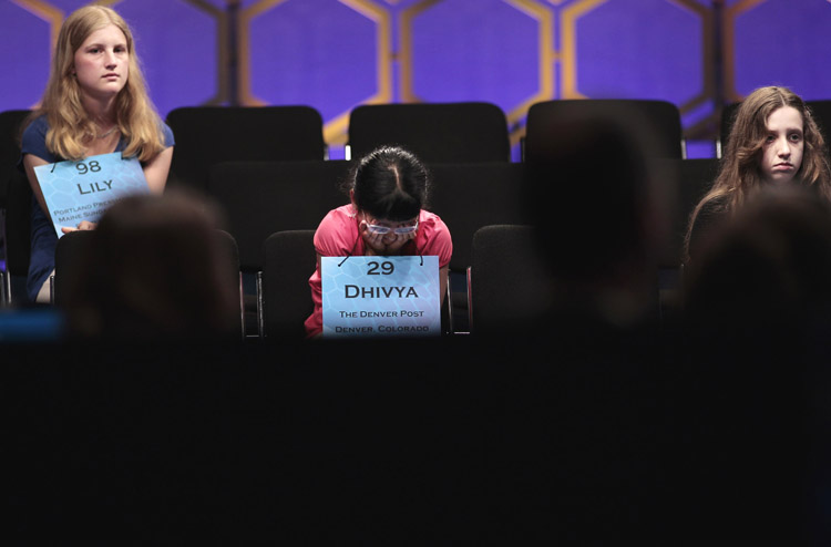 From left to right, Lily Jordan, 14, of Cape Elizabeth, Dhivya Senthil Murugan, 10, from Denver, Colo., and Veronica I. Penny, 13, from Ottawa, Canada sit through the end of the semifinals of the 2011 Scripps National Spelling Bee today.
