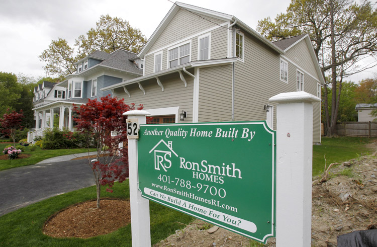 A sign advertises a newly constructed house in Providence, R.I., recently. U.S. homebuilders are concerned that the struggling housing market won't recover this year and some feel it may be getting worse.