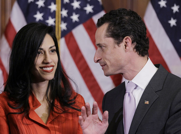 A Jan. 5, 2011, photo of Rep. Anthony Weiner, D-N.Y., and his wife, Huma Abedin, aide to Secretary of State Hillary Rodham Clinton. Sources say Weiner is waiting for Abedin to return from an overseas trip before making a decision on whether or not to resign.