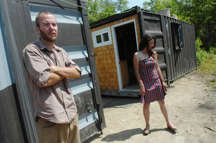 Trevor Seip and Jennifer Sansosti stand outside their shipping container home in Ellsworth. The couple have transformed two 20-foot-long containers - which they bought on eBay - into their home.