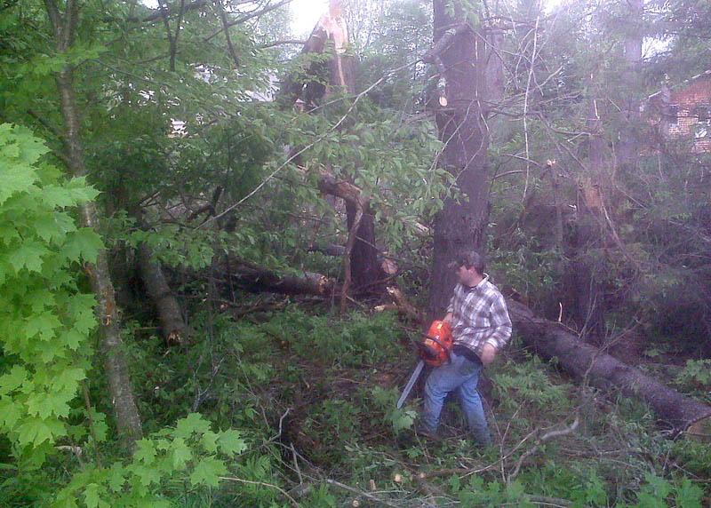 Michael Boothby helps clear debris Thursday morning in Embden after high winds or possibly a tornado touched down there about 6 p.m. Wednesday. Joey Hibbard, a nearby neighbor to the scene, said he saw a funnel cloud Wednesday evening.