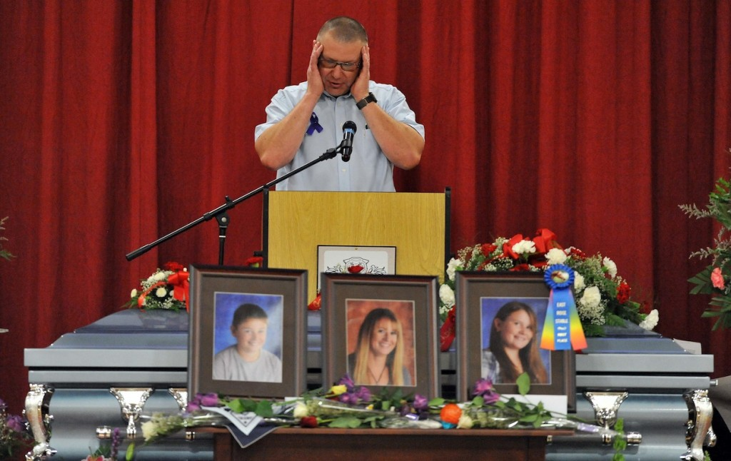 Ron Bagley, cousin of Amy Lake, speaks during funeral services for Amy, Coty and Monica Lake at Dexter Regional High School in Dexter, Saturday, June 18, 2011.