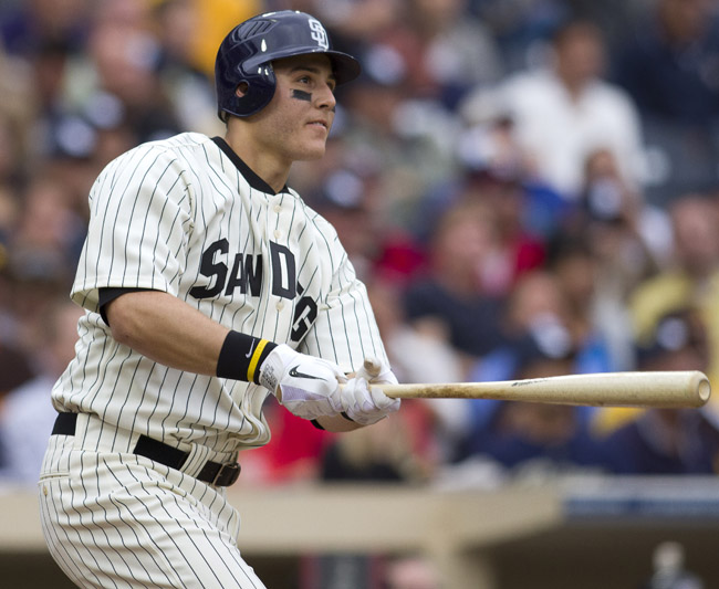 In this June 11, 2011, photo, San Diego Padres' Anthony Rizzo follows through on a one-run home run during a game against the Washington Nationals.