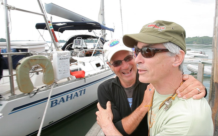 Nat Warren-White, left, laughs with friend Sam Kilbourn after Warren-White returned to Freeport from a 4½-year circumnavigation of the globe with his wife Betsy.
