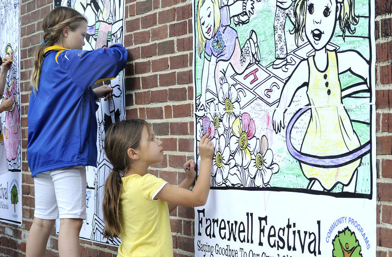 Kylie Sabo, 9, colors a wall mural at the Falmouth Farewell Festival for parents and students at the Plummer-Motz and Lunt elementary schools in Falmouth on Friday.
