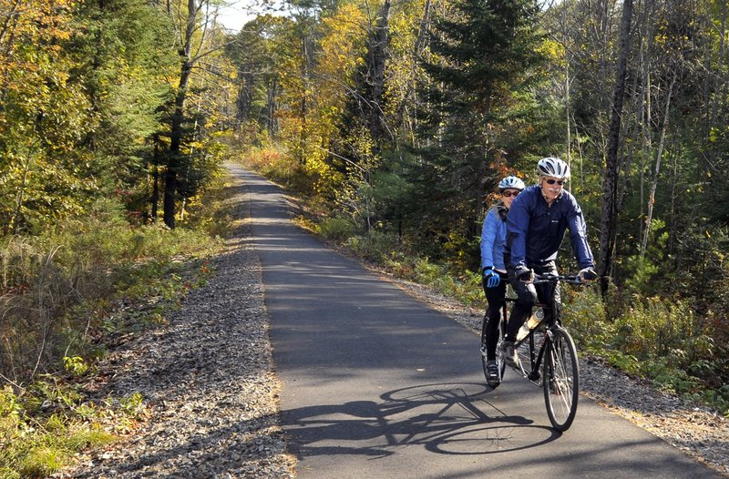 Dave Kinsman and his wife, Connie, enjoy a tandem bike ride on the paved connector from Shaw Park to the Mountain Division Trail in Gorham.