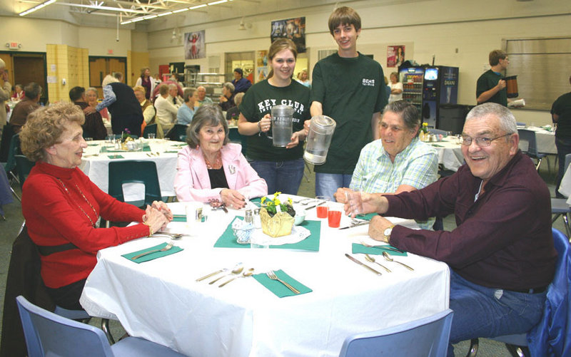 Bonny Eagle High School students, from left, Sara Clark and Matthew Hoyt, serve guests at Senior Citizens Night. Pictured, front from left, are Anita Cornish, Hollis; Lloma Raychard, Buxton; and Paul and Nellie Hanson, Standish.