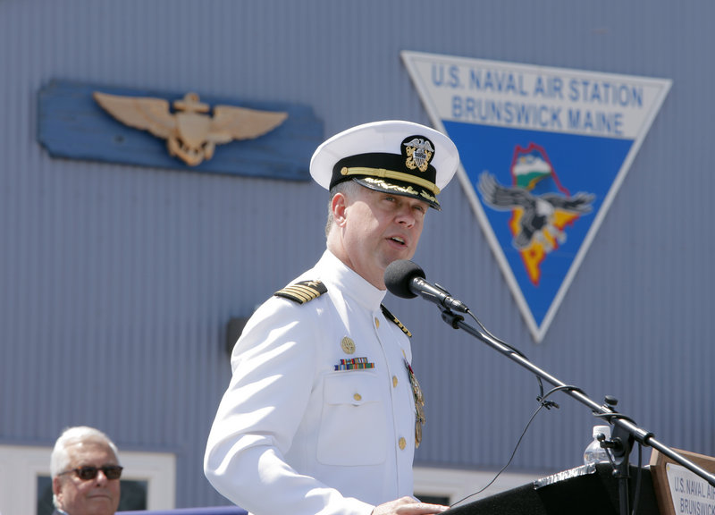 "Capt. William A. Fitzgerald, Brunswick Naval Air Station's commanding officer, addresses the crowd Tuesday. ""Thank you for accepting us, embracing us, for making each of us who have served here and lived here better,"" he said."