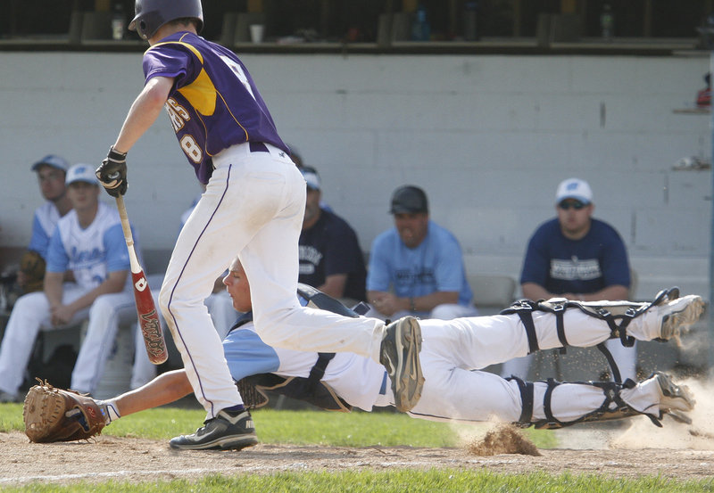 Westbrook catcher Kyle Heath dives Tuesday to snag a bunt by Tyler Flaherty of Cheverus in the fourth inning of Cheverus' 6-2 victory in eight innings at Olmsted Field. Heath made the catch, then threw out a runner at second base to complete a double play.