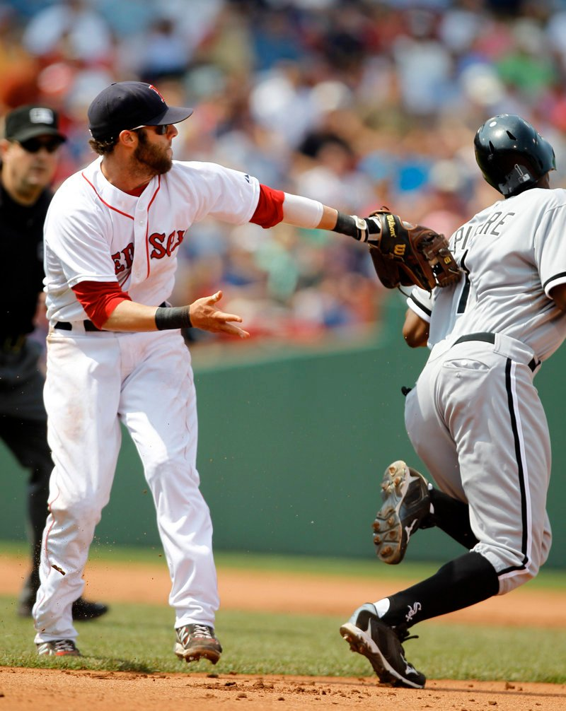 Dustin Pedroia of the Red Sox reaches to tag Juan Pierre of the Chicago White Sox, who stole second in the fifth inning of Chicago's 7-4 win Wednesday at Fenway Park.