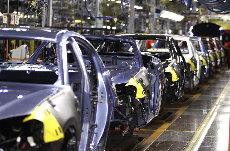 The new, midsize Chrysler 200, seen on an assembly line in Sterling Heights, Mich., helped the automaker achieve a 10 percent sales hike over May 2010.