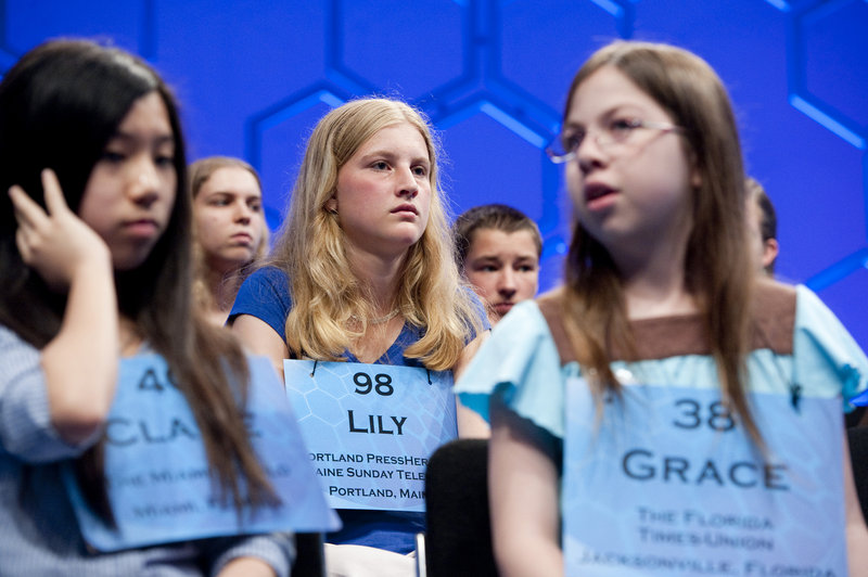 Maine's Lily Jordan, No. 98 in the National Spelling Bee, is surrounded by fellow competitors during the semifinals Thursday at the Gaylord National Resort and Convention Center in National Harbor, Md.