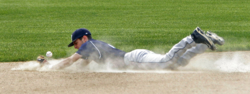 Anthony Sciaudone of York dives in an attempt to stop a ball that went for a single for Gray-New Gloucester, which finished the regular season with a 10-6 record. York finished 8-8.