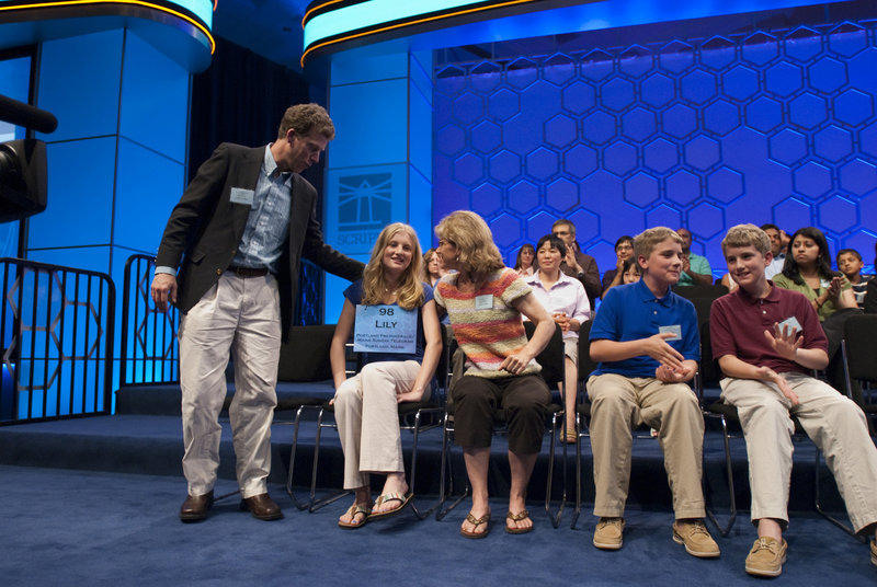 Maine champion speller Lily Jordan rejoins her family, parents Glenn and Nancy Jordan and her brothers Nathaniel and Jacob Jordan, after she was eliminated from the National Spelling Bee on Thursday night.