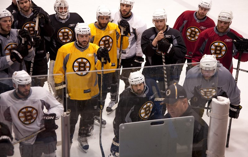 Bruins Coach Claude Julien goes over a few points – about the power play, perhaps? – during practice on Friday in Vancouver, British Columbia. The Canucks took a 1-0 series lead with a last-minute goal Wednesday night.