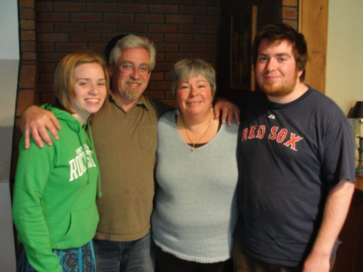 Andrew Holland, shown with his sister Carolyn and parents, Ward and Lynne, died Tuesday of a gunshot wound. A friend has been charged with manslaughter in his death.
