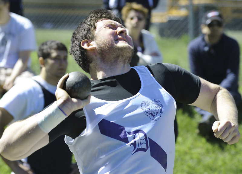 Deering High's Brian White heaves the shot 50 feet, 7 3/4 inches to win his event Saturday in the Class A track and field championship at Windham High School.
