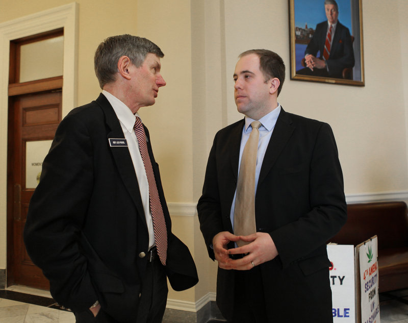 Rep. Les Fossel, R-Alna, left, speaks with Sen. Seth Goodall, D-Richmond, at the State House on Feb. 10. Centrist Democrats and Republicans are joining forces to make their voices heard and to forge a compromise on partisan issues in Augusta.