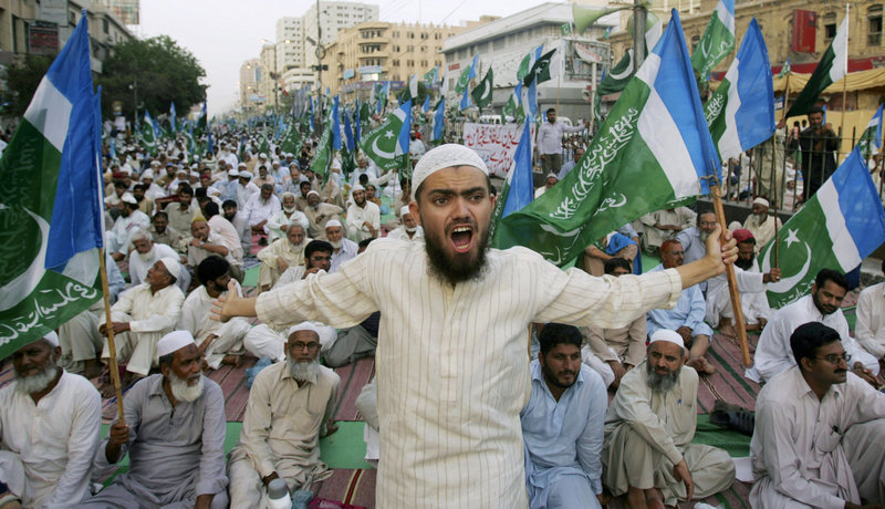 A supporter of the Pakistani religious party Jamaat-e-Islami shouts during a rally against drone attacks Saturday in Karachi, Pakistan. Ilyas Kashmiri, a top al-Qaida commander and possible replacement for Osama bin Laden who was accused of the 2008 Mumbai massacre, was believed killed in an American drone-fired missile strike close to the Afghan border.