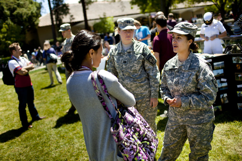 Kaitlyn Benitez-Strine, 17, left, talks about the military with ROTC representatives Anna Thompson, 22, center, and Isabel Lopez, 18, at Stanford University in California in April.