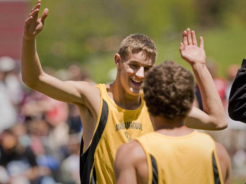 Chris Pelletier of Maranacook celebrates his victory in the triple jump Saturday in the Class C state meet at Bath.