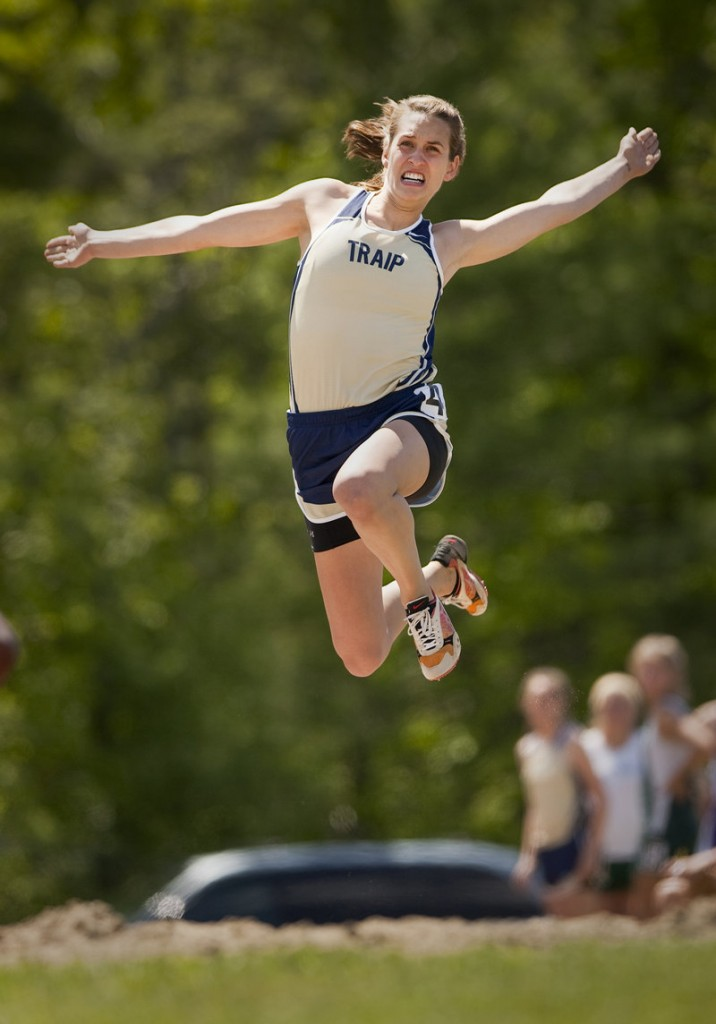 Carley O'Brien of Traip Academy hits her takeoff and travels 16 feet, 8 1/4 inches to finish first in the long jump in the Class C meet. O'Brien helped the Rangers capture the girls' team title, edging John Bapst by three points.