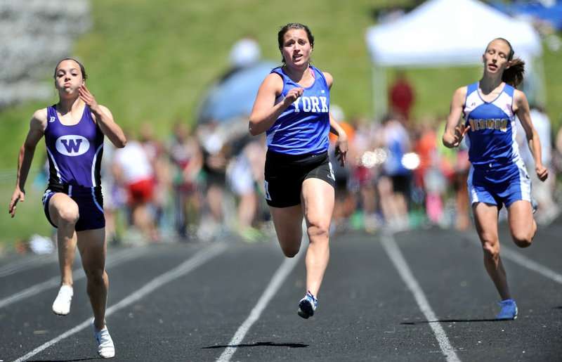 Emily Mitchell, center, of York competes in the 100-meter dash in the Class B meet. Mitchell was runner-up in the finals to Georgia Bolduc of Waterville.