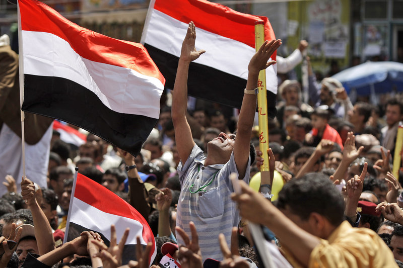 An anti-government protester, center, celebrates with other demonstrators the departure of President Ali Abdullah Saleh to Saudi Arabia in San'a, Yemen, on Sunday.