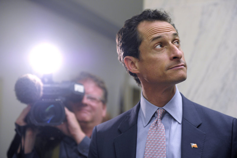 Rep. Anthony Weiner, D-N.Y., waits for an elevator as photographers surround him in this June 6 file photo.