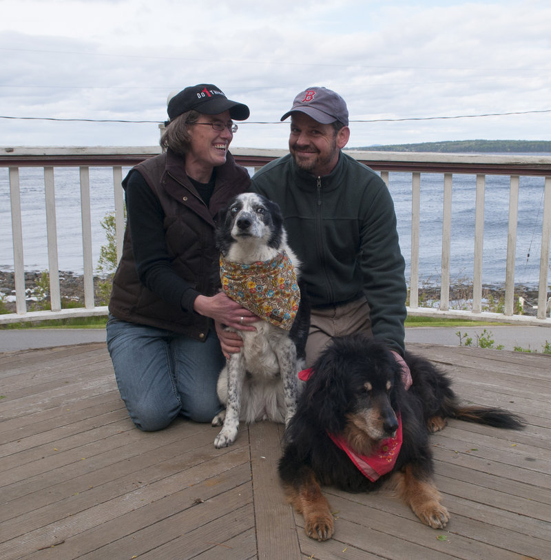 Jennifer Smith-Mayo and Matthew Mayo with their dogs, Guinness and Nessie.