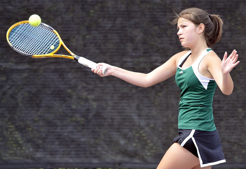 Kaitlyn Thompson of Waynflete hits a return during her No. 1 singles match against Nikki Scott of Winthrop in the Western Class C girls team tennis final Wednesday at Bates College in Lewiston. Scott won the match in three sets, but Waynflete captured the regional title with a 3-2 victory.