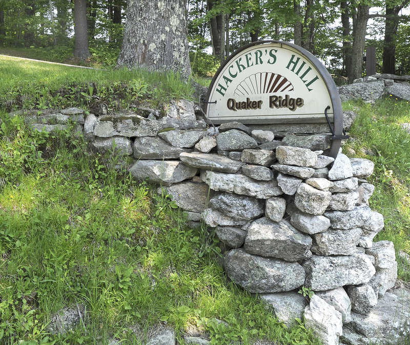 A sign at the bottom of Quaker Ridge points to Hacker's Hill. From atop the hill, miles of mountains and lakes can be seen.
