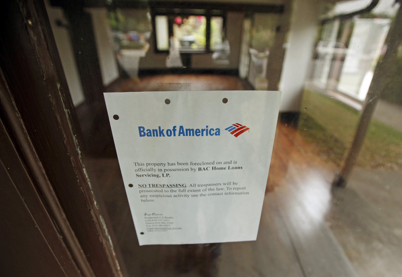 A Bank of America foreclosure notice is seen in the front window of a home in Los Angeles. The Obama administration says that the three largest U.S. lenders haven't helped enough people lower their mortgage payments to stay in their homes.