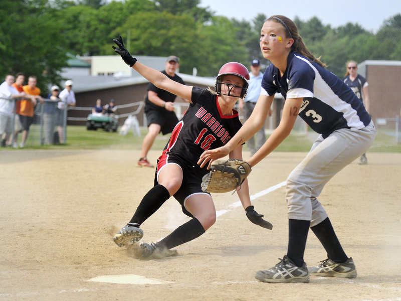 Yarmouth first baseman Cassidy Cleaves awaits the throw at home plate as Sophie Lamb scores the first run for Wells in the third after the ball got past the catcher. Wells won the Western Class B quarterfinal 3-1 in nine innings.