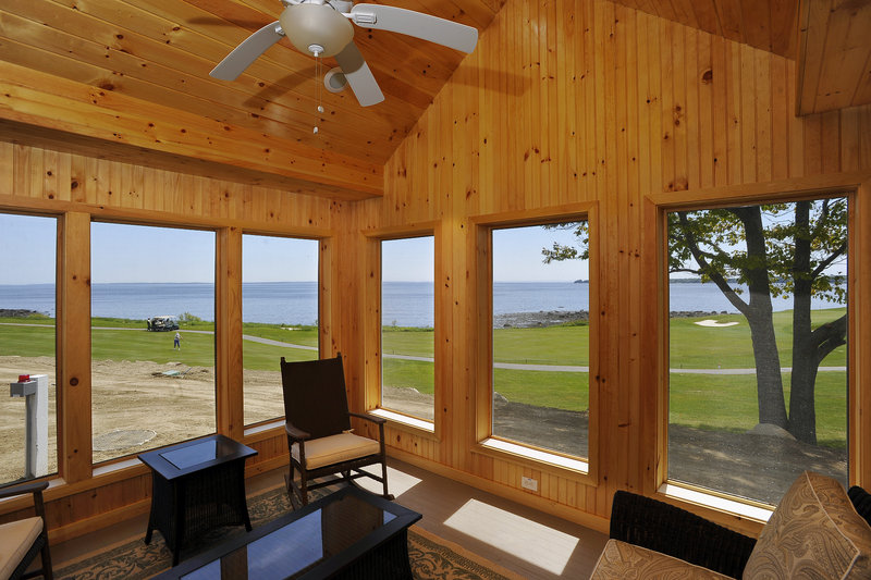 This screened-in sitting room in one of the new cottages overlooks the golf course on the ocean at the Samoset Resort in Rockport.