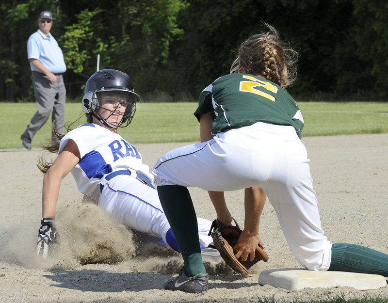 Maura Ester of McAuley blocks third base and tags out Kennebunk's Meg Cadigan during a Class A softball quarterfinal Friday at Portland. McAuley advanced with a 7-6 victory and will face top-seeded South Portland next.