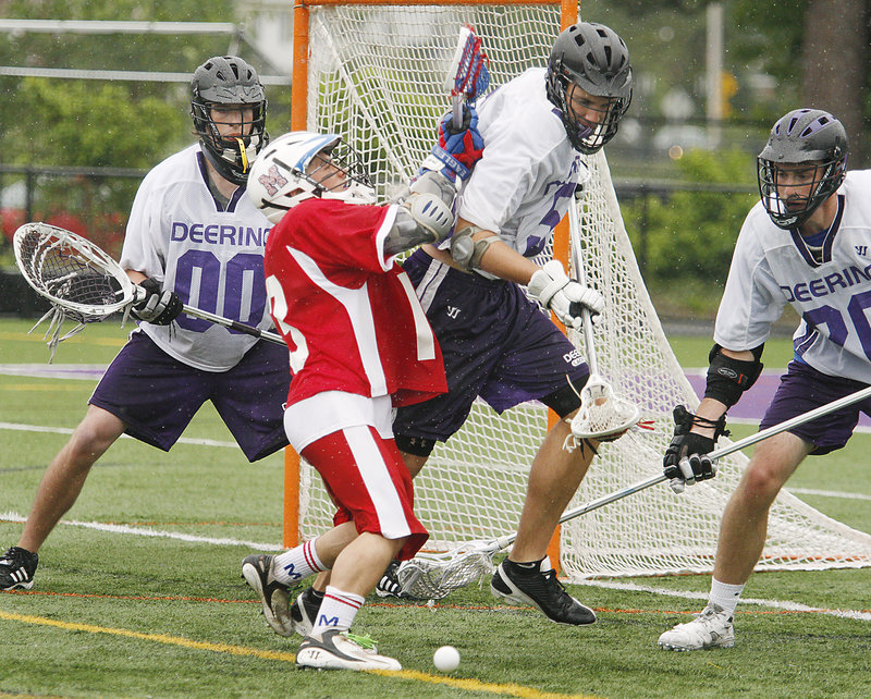 Luke Vigue of Messalonskee, in red, has the ball stripped by James Doyle of Deering during their Eastern Class A schoolboy lacrosse semifinal Saturday. Deering won, 8-6.