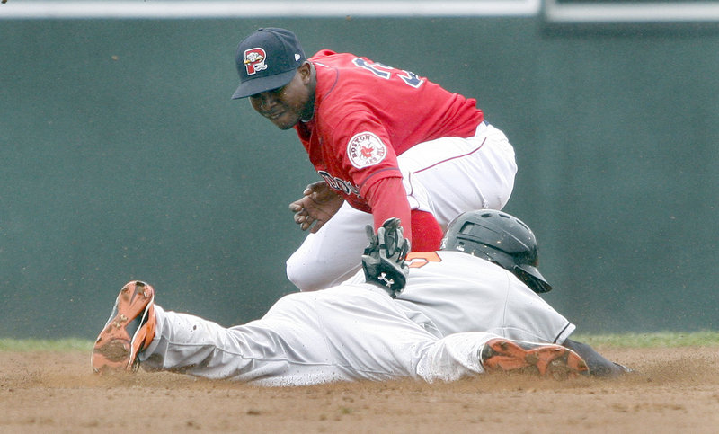 Sea Dogs second baseman Oscar Tejeda tags out Bowie's Xavier Avery, who was trying to stretch a single into a double. Portland lost 10-7 in the opener of a scheduled doubleheader, and the second game was postponed.