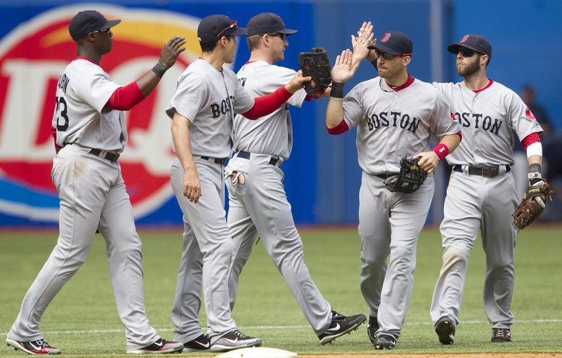 Red Sox Mike Cameron, Jacoby Ellsbury, J.D. Drew, Marco Scutaro and Dustin Pedroia celebrate their 14-1 win Sunday at Toronto. Boston swept the three-game series, outscoring the Jays, 35-6. David Ortiz and Kevin Youkilis were the big hitters Sunday. They each had a homer and four RBI.
