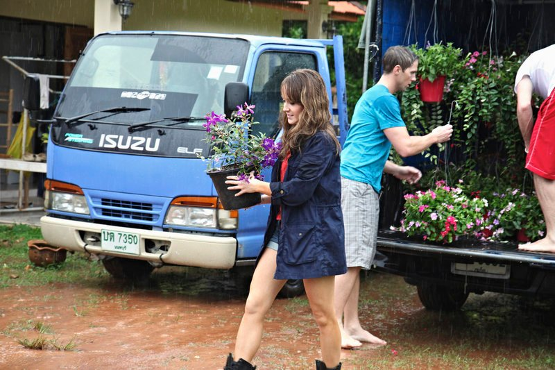 Bachelorette Ashley Hebert got back in romance mode Monday by taking the remaining bachelors to Thailand, where she and 10 of her suitors helped renovate an orphanage.
